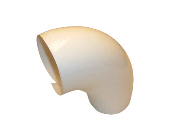 A one-piece, 90 degree elbow fabricated out of PVC