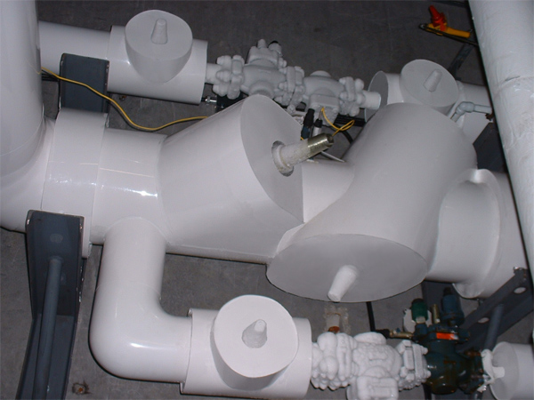 A series of pipes and fittings covered in PVC
